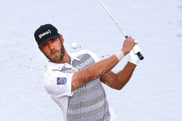 Graham DeLaet, of Canada, watches his sand shot on the third hole in his match against Patrick Reed during the first round of the Match Play Championship golf tournament on Wednesday, Feb. 19, 2014, in Marana, Ariz. (AP Photo/Matt York)