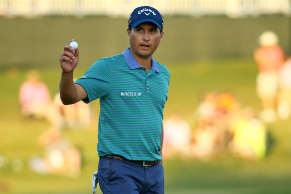 PONTE VEDRA BEACH, FL - MAY 10:  Kevin Kisner holds up his ball after putting on the 17th green during a playoff in the final round of THE PLAYERS Championship at the TPC Sawgrass Stadium course on May 10, 2015 in Ponte Vedra Beach, Florida.  (Photo by Richard Heathcote/Getty Images)