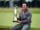 Northern Ireland's Rory McIlroy holds the Claret Jug as his poses for a photograph after winning the 2014 British Open Golf Championship at Royal Liverpool Golf Course in Hoylake, north west England on July 20, 2014. McIlroy won the British Open at Royal Liverpool Golf Course in Hoylake with a final round of 71. The 25-year-old Northern Irishman won with a seventeen under par total of 271, two strokes clear of Rickie Fowler and Sergio Garcia. Rory McIlroy joined the elite list of golfers to have won three of the four major titles at Hoylake on Sunday. At 25, McIlroy joined legends Tiger Woods and Jack Nicklaus as the only players to have achieved that feat by the time they were 25 and he is the first European to have won three majors. AFP PHOTO / ANDREW YATESANDREW YATES/AFP/Getty Images
