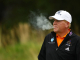 SYDNEY, AUSTRALIA - DECEMBER 02:  John Daly of the USA smokes a cigarette during day one of the Australian Open at The Lakes Golf Club on December 2, 2010 in Sydney, Australia.  (Photo by Matt King/Getty Images)