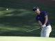 Sang-Moon Bae, of Korea, chips to the 10th green during a practice round for the Masters golf tournament Monday, April 2, 2012, in Augusta, Ga. (AP Photo/Chris O'Meara)